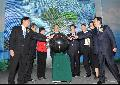 Mr Tang (fourth left) and other officiating guests perform a lighting ceremony to mark the completion of reconstruction projects.